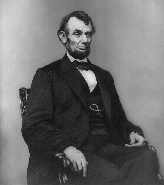 Abraham_Lincoln_seated,_Feb_9,_1864 (via Wikipedia)